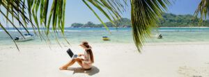 woman-working-in-tropics-on-beach-thejoinclub